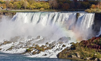 Beautiful image with amazing powerful Niagara waterfall and a rainbow