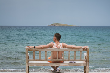 Enjoying life. Young man looking at the sea, vacations lifestyle concept