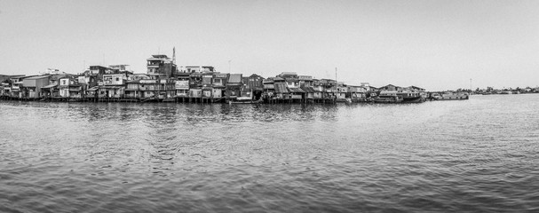 Panorama houses on river. Black and white