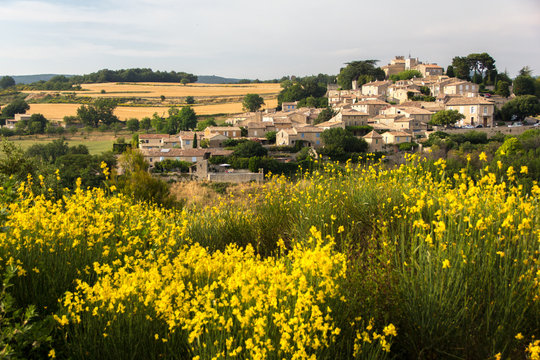 Miniature effect of small provence village on hill in countryside -Roofs in golden sunset – Family trip to France