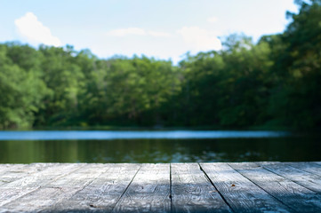 Foto op Aluminium Meer / Vijver Beautiful forest and lake with a wooden board.