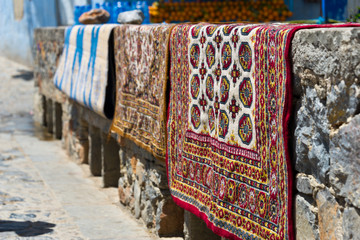 carpets drying after laundry in chefchaouen, morocco