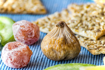 Dry fruits in sugar and crispy crackers with seeds. Healthy Eating