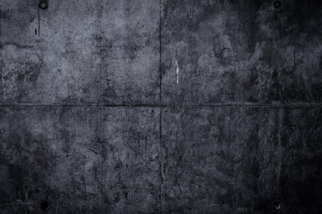 Simple dark concrete wall background with texture