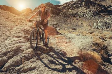Bike traveler rides on mountain race
