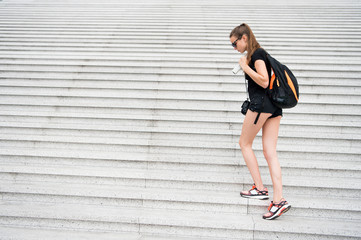 pretty girl or woman walking on the stairs