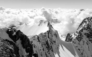 Clouds over snow covered mountains.