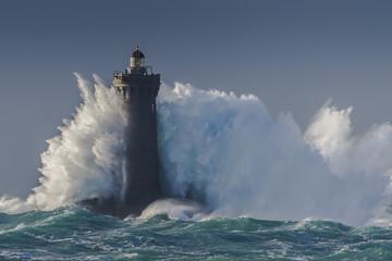 Waves crashing against a lighthouse.