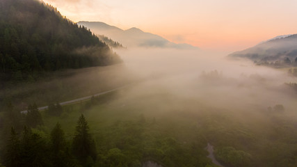 Wall Murals Cappuccino Aerial view mist hovering across a valley.