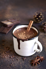 Canvas Prints Chocolate Homemade spicy hot chocolate with cinnamon in enamel mug.