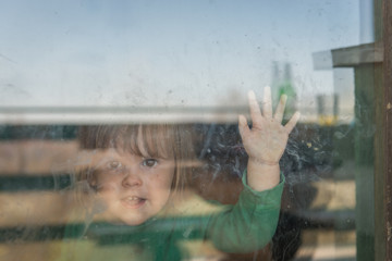 Child standing on home window