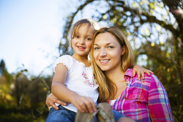 Portrait of mother and daughter outdoors, Munich, Bavaria, Germany