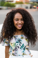 Young black woman smiling and looking at camera