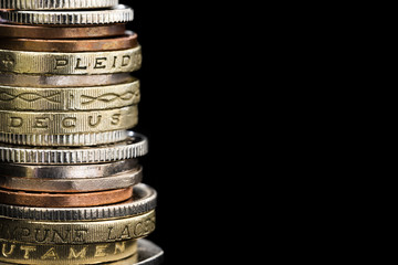 Stack of British Coins over Black