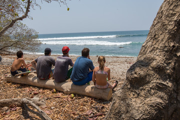 Surfers check out the conditions in Santa Teresa, Costa Rica