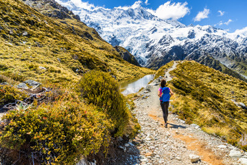 New zealand hiking girl hiker on Mount Cook Sealy Tarns trail in the southern alps, south island. Travel adventure lifestyle tourist woman walking alone on Mueller Hut route in the mountains.