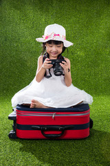 Asian Little Chinese girl playing with camera