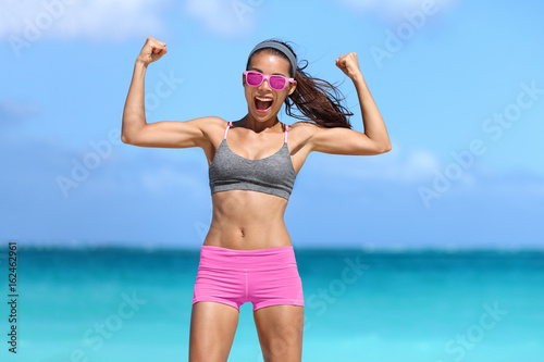 check out 0d263 31697 Strong fitness woman showing off muscular arms flexing ...