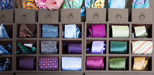 collection of ties on hangers in men boutique