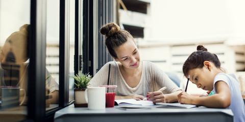Woman And Girl Doing Homework Concept