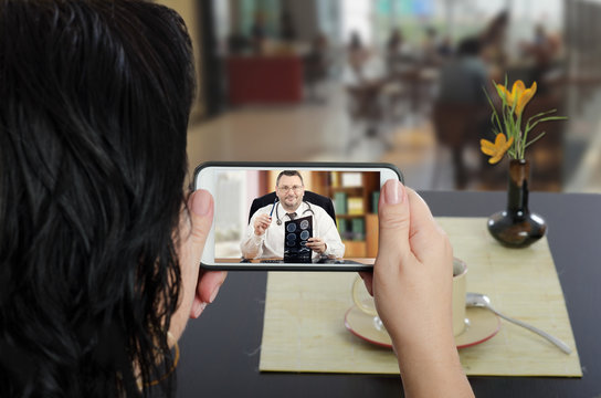 Woman consults a telemedicine doctor  by mobile phone