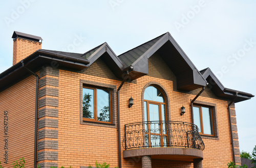Brick house construction with different types of roof design and