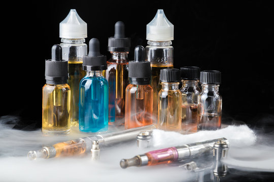 Collection of vape equipment with smoke