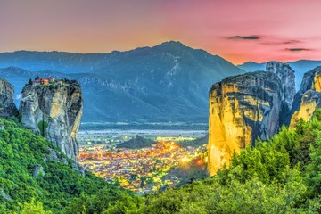 Wall Mural - Holy Trinity Monastery and kalambaka village at blue hour time, Meteora, Greece.