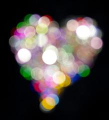 Heart Shape Made of Glitter on Black Background