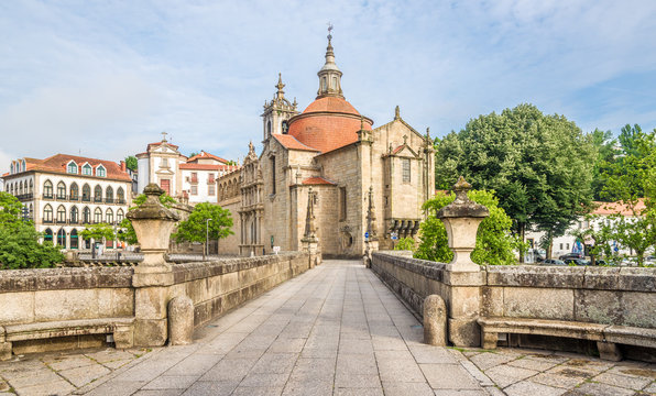 View at the Sao Goncalo monastery through the Old bridge over the river Tamega in Amarante ,Portugal