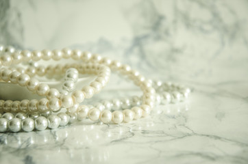 natural pearls on marble table