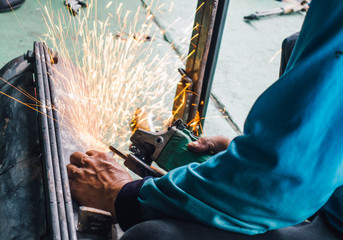 Careless worker use hand welding without safety gloves
