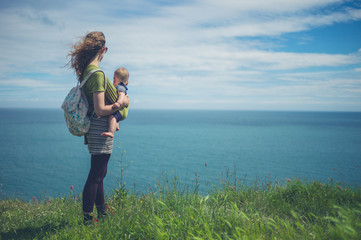 Woman with baby by the sea