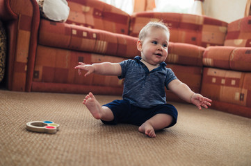 Little baby playing on living room floor