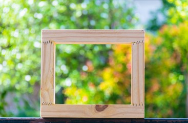 Picture frame on blurred tree background using wallpaper or background.