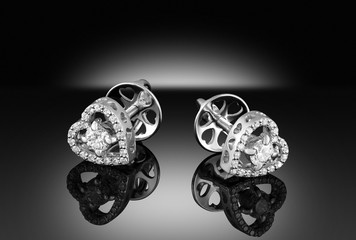 A pair of white gold heart shape earrings with diamonds la poussette