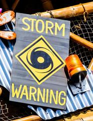 old storm warning sign