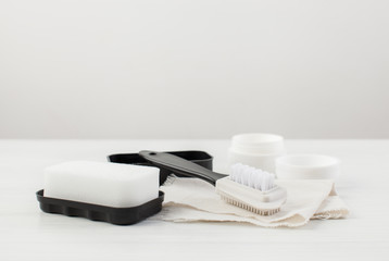 Brush, sponge, cloth and cream for white shoes