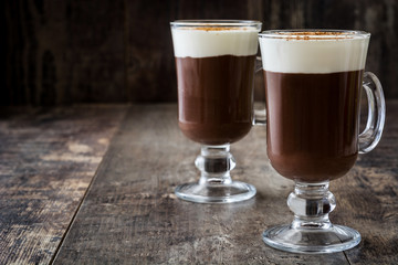 Irish coffee in glass on wooden table