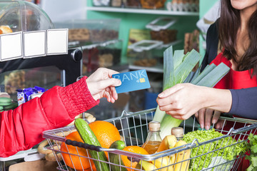 customer pays with card in grocery