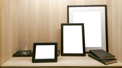 Blank picture frame template set for Photo or picture painting art gallery in interior Placed on the table.