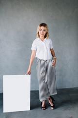 business woman standing next a presentation easel