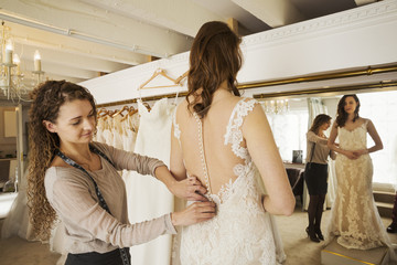 A Dressmaker Taking In Wedding Dress Pinning And Fitting It To The Client