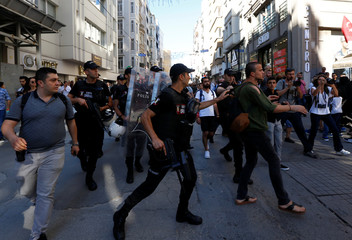 Riot police disperse LGBT rights activists as they try to gather for a pride parade in central Istanbul