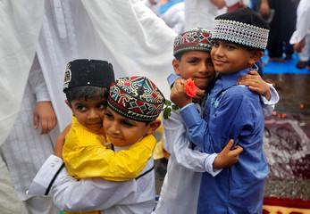 Children greet each other after offering Eid al-Fitr prayers in Mumbai