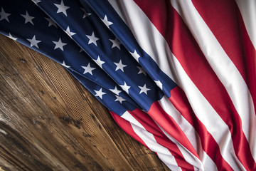 American flag on wooden background. Place for text or typography.