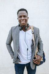 Portrait of smiling young man with backpack