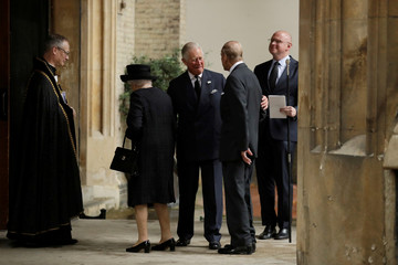 Britain's Queen Elizabeth and Prince Philip are greeted by Prince Charles as they arrive to attend the funeral service of Patricia Knatchbull, the Countess Mountbatten of Burma at St Paul's Church in Knightsbridge, London