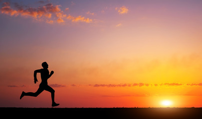 Running man silhouette in sunset time. Sport and active life concept