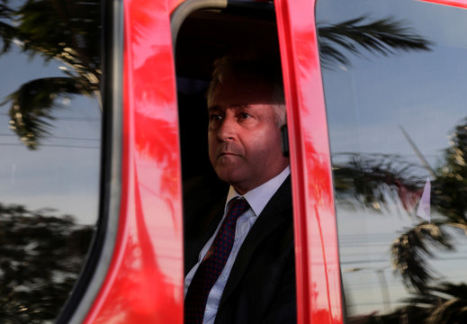 Vice President of River Plate Patanian sits in a car en route to the CONMEBOL headquarters after players Mayada and Martinez Quarta tested positive for anti-doping controls, in Luque